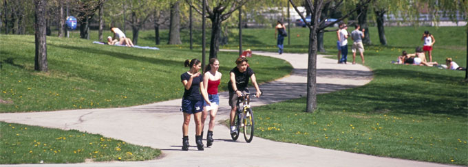 Students biking and rollerblading on UB's North Campus